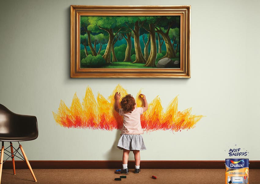 child drawing fire on wall