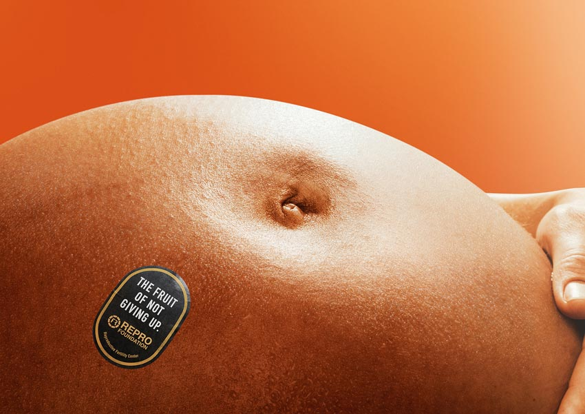 closeup of pregnant belly that looks like an orange